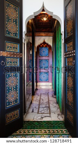 Moroccan painted doors and marble hallway.  Location: Interior in Marrakech, Morocco - stock photo