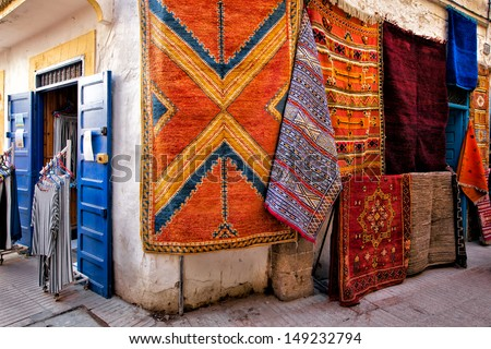 Moroccan Rugs In Typical Patterns And Colors For Sale On The Street In  Essaouira, Morocco