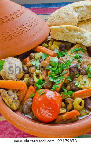 "Moroccan ""seven vegetables"" tagine served with freshly baked homemade sesame bread - stock photo"