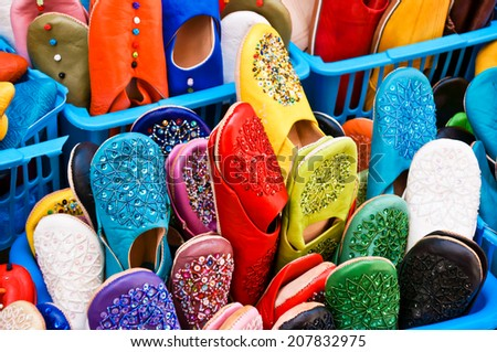moroccan slippers in a market - stock photo