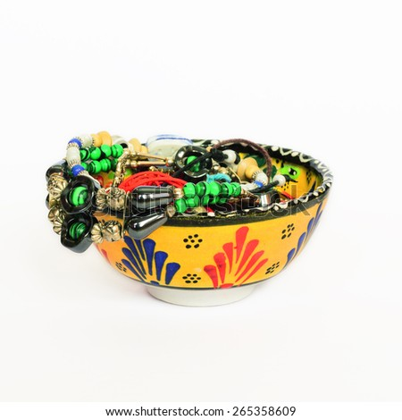 Moroccan small bowl with various souvenir bracelets - stock photo