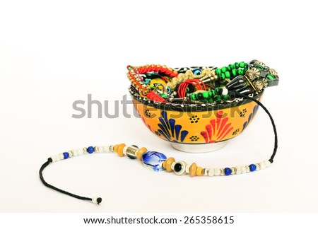 Moroccan small bowl with various souvenir bracelets