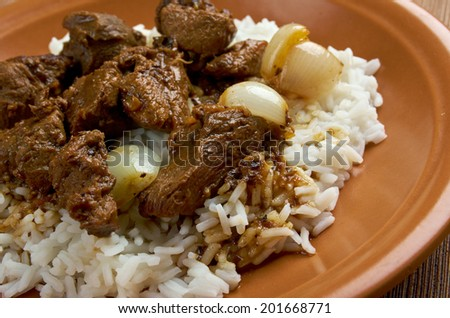 Moroccan Tagine with tender lamb and rice - stock photo