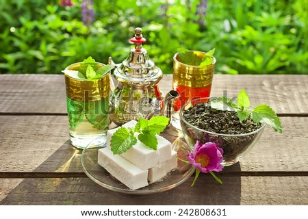 Moroccan tea cups and mint tea  - stock photo
