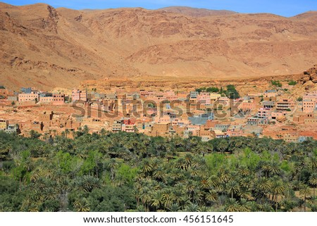 Moroccan  village on the Eastern slopes of the Atlas Mountains at Tinerhir oasis - stock photo