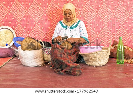 MOROCCO, AURIKA VALLEY - OCTOBER 24: Woman at work in a cooperative for manufacturing argan oil on 24th october in Morocco - stock photo