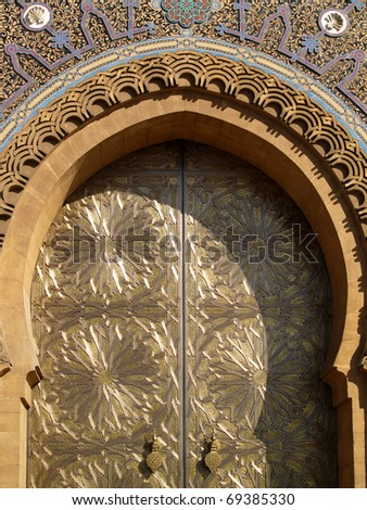 Morocco Casablanca Royal Palace door with Arabesque arch intricately engraved brass panel door and colorful ceramic tiles