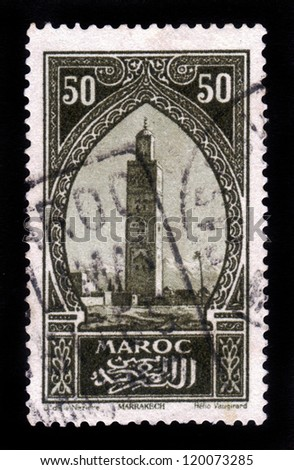 MOROCCO - CIRCA 1934: A stamp printed in Morocco shows Koutoubia, the biggest mosque of the Moroccan city of Marrakesh, circa 1934 - stock photo