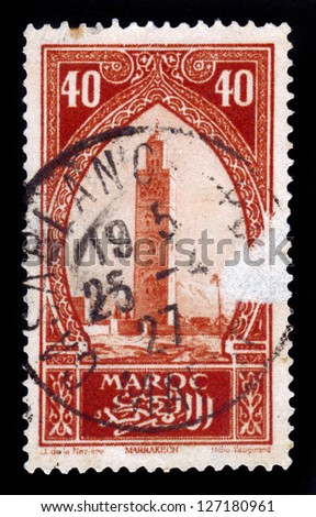 MOROCCO - CIRCA 1934: A stamp printed in Morocco shows Koutoubia, the biggest mosque of the Moroccan city of Marrakesh, red, circa 1934 - stock photo
