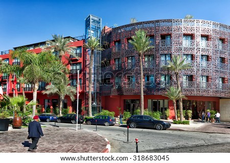 MOROCCO-DEC 24, 2012: Modern hotels in an upscale Marrakech business and residential district. Tourism is a leading industry in Morocco, and Marrakech is one of the the country's most visited cities. - stock photo