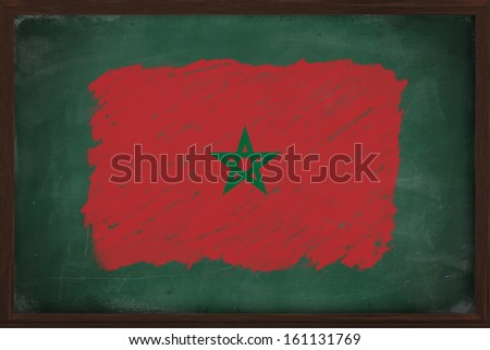 Morocco flag painted with color chalk on old blackboard
