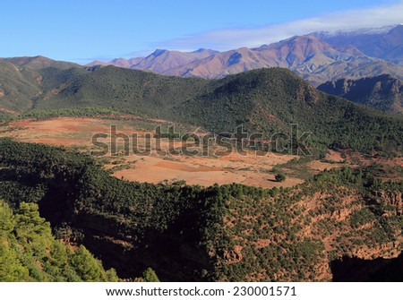 Morocco, High Atlas Mountains, peaks and a fertile high plain in springtime, on the route between Marrakesh and Ouarzazate. - stock photo
