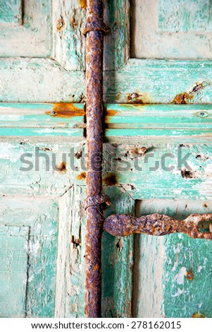 morocco in africa the old wood  facade home and rusty safe padlock  - stock photo