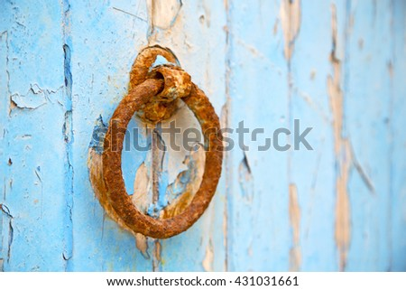 morocco knocker in africa the old wood  facade home and rusty safe padlock  - stock photo