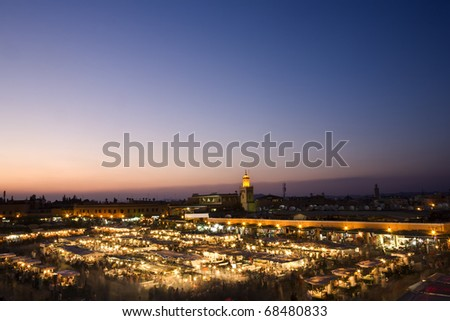 Morocco. Marrakech. The Jemaa el-Fna Square at sunset. Blurred motion in the foreground