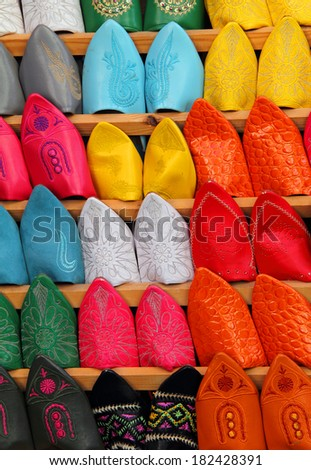 Morocco, Marrakesh, Typical colourful 'babuchas' - hand crafted leather slippers on display in the Medina souk. UNESCO World Heritage site. - stock photo