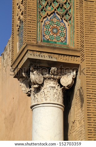 Morocco, Meknes, Historical centre. The medieval Bab Mansour gate. Detail of Arabesque design with mosaic ceramic tiles and Roman column removed from nearby Volubilis. UNESCO World Heritage site. - stock photo