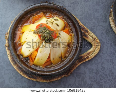 Morocco national dish - tajine of meat with vegetables - stock photo