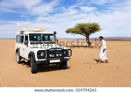 MOROCCO - OCTOBER 27, 2015 : Unidentified berber man in Sahara Desert, Morocco, Africa - stock photo