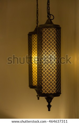 Morocco style lamp inside a moroccan interior room at night.