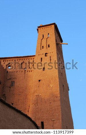 Morocco: Sunset at the clay kasbah of Ait Benhaddou, a 'fortified city' or ksar, between the caravan route Sahara-Marrakech. - stock photo