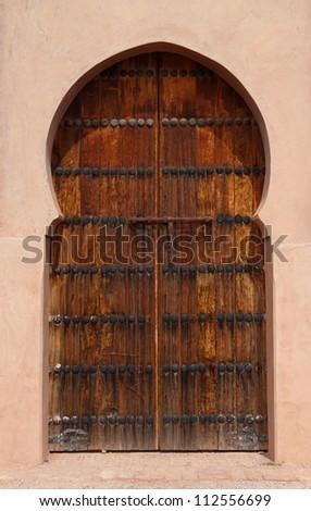 Morocco 12th Century Tin Mel or Tinmal Mosque in the High Atlas Mountains Arabesque wooden door - UNESCO World Heritage Site - stock photo