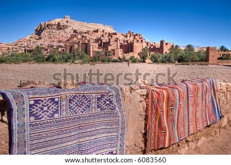 morocco wild  landscape with carpet and ancient ksar palace - stock photo