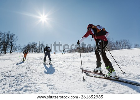 MOROZNAYA MOUNT, KAMCHATKA, RUSSIA - APRIL 25, 2014: Group ski mountaineers climb on skis on Moroznaya Mountain. Vertical race ski mountaineering Asian, ISMF, Russian, Kamchatka Championship. - stock photo