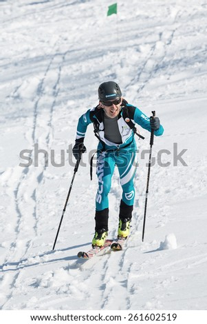 MOROZNAYA MOUNT, KAMCHATKA, RUSSIA - APRIL 25, 2014: Ski mountaineer Konstantin Savchuk climb on skis on mountain. Vertical race ski mountaineering Asian, ISMF, Russian, Kamchatka Championship. - stock photo
