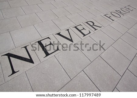 MORRIS PLAINS, NJ-SEPT 11: Tiles that read 'Never Forget' lay within the 911 memorial grounds on the 11th anniversary of the terror attacks on September 11, 2012 in Morris Plains, NJ. - stock photo