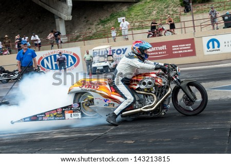 Michelin ou quoi ?? Stock-photo-morrison-co-june-bike-does-a-burnout-during-thunder-on-the-mountain-presented-by-grease-143213815
