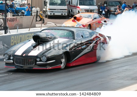 Morrison, CO - June 16, 2013: Car 532 Does a burnout during Thunder on the Mountain presented by Grease Monkey at Bandimere Speedway. - stock photo
