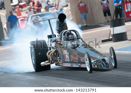 MORRISON, CO - JUNE 15: Gary Stinnett in his Super Comp dragster does a burnout during Thunder on the Mountain presented by Grease Monkey at Bandimere Speedway on June, 15, 2013 in Morrison, Co.  - stock photo