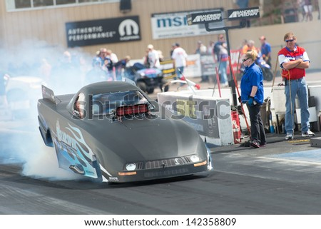 Morrison, CO - June 15, 2013: Jirka Kaplan Top Alcohol Funny Car does a burnout during Thunder on the Mountain presented by Grease Monkey at Bandimere Speedway. - stock photo