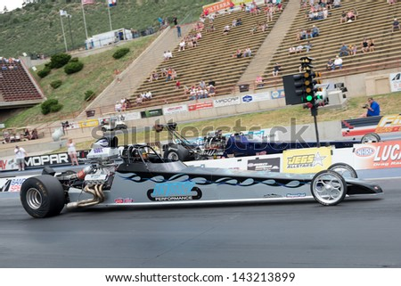MORRISON, CO - JUNE 15: Top Dragster Anthony Stark Car 5301 beating  Michael Candelairo Car 5224 off the light during Thunder on the Mountain presented by Grease Monkey at Bandimere Speedway on June, 15, 2013 in Morrison, Co.  - stock photo