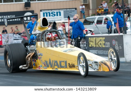 MORRISON, CO - JUNE 15: Top Dragster Chris Woolverton Car 5238 does a wheelie at the starting line during Thunder on the Mountain presented by Grease Monkey at Bandimere Speedway on June, 15, 2013 in Morrison, Co.  - stock photo