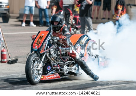 Morrison, CO - June 16, 2013: Top Fuel Harley 66 does a burnout during Thunder on the Mountain presented by Grease Monkey at Bandimere Speedway. - stock photo