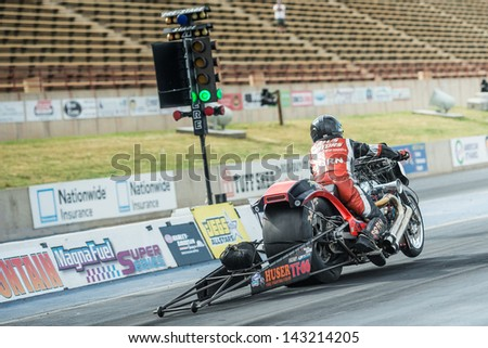 MORRISON, CO - JUNE 15: Top Fuel Harley Steve Dorn Bike 66 wheelies at the green light during Thunder on the Mountain presented by Grease Monkey at Bandimere Speedway on June, 15, 2013 in Morrison, Co.  - stock photo