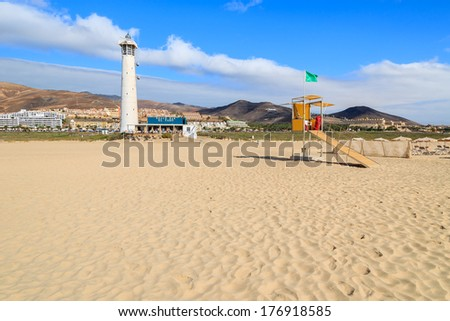 MORRO JABLE, FUERTEVENTURA - FEB 9: Lighthouse and lifeguard booth on Morro Jable beach on Jandia peninsula on 9th Feb 2014, Fuerteventura, Canary Islands, Spain