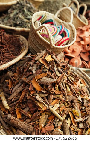morrocan herbs flowers spices - cassia barks - in the Marrakesh street shop, shallow dof - stock photo