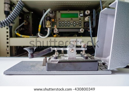 morse key telegraph in front of the radio - stock photo