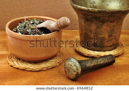 Mortar and bowl with herbs - stock photo