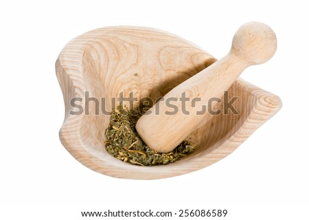 Mortar and dried herbs, isolated on white - stock photo