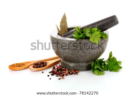 Mortar and pestle, parsley, bay leaf and pepper isolated on white - stock photo