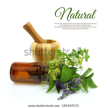 Mortar and pestle with fresh herbs and medical bottle - stock photo