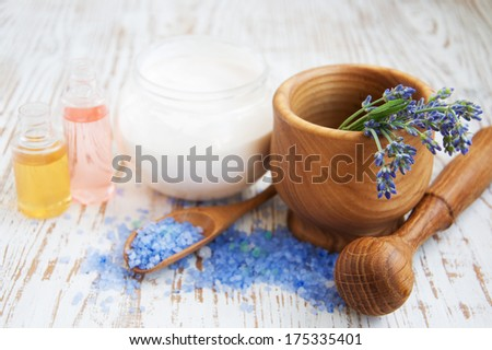 Mortar and pestle with lavender salt on a wooden background
