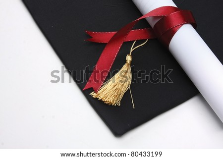 mortar board and the roll of diploma - stock photo