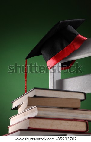mortar board on the chair - stock photo
