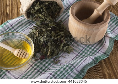 mortar, pestle, honey and herbal tea. - stock photo