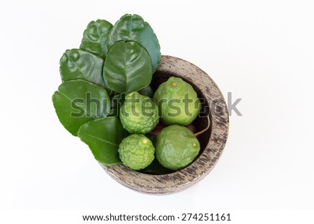 Mortar  with  Bergamot and Kaffir lime leaves on white background - stock photo